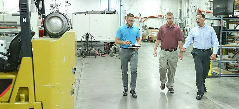 Leadership walking through Impact Molding shopfloor